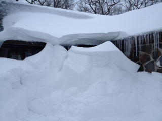 Snow piled high at the front door